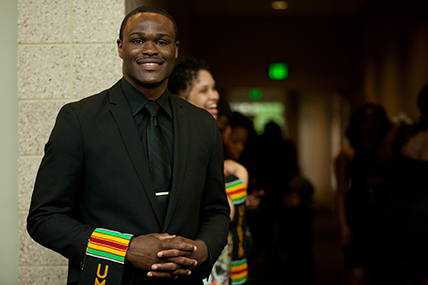 adult man posing with hands clasped at the Umoja: Black Graduation Celebration