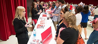 prospective students and families at an open house
