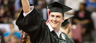 Male student in cap and gown at commencement